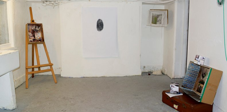 View of a photographic exhibition at the former Grey Area, with an alternative presentation of photographs in boxes during the Brighton Photo Fringe 2014. Photo by Eva Kalpadaki.